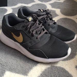 Grey Nike Tanjun shoes
